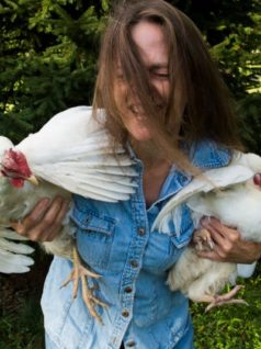 happy owner holding two chickens